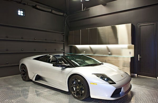 Luxury garages swagger magazine for Luxury garage designs