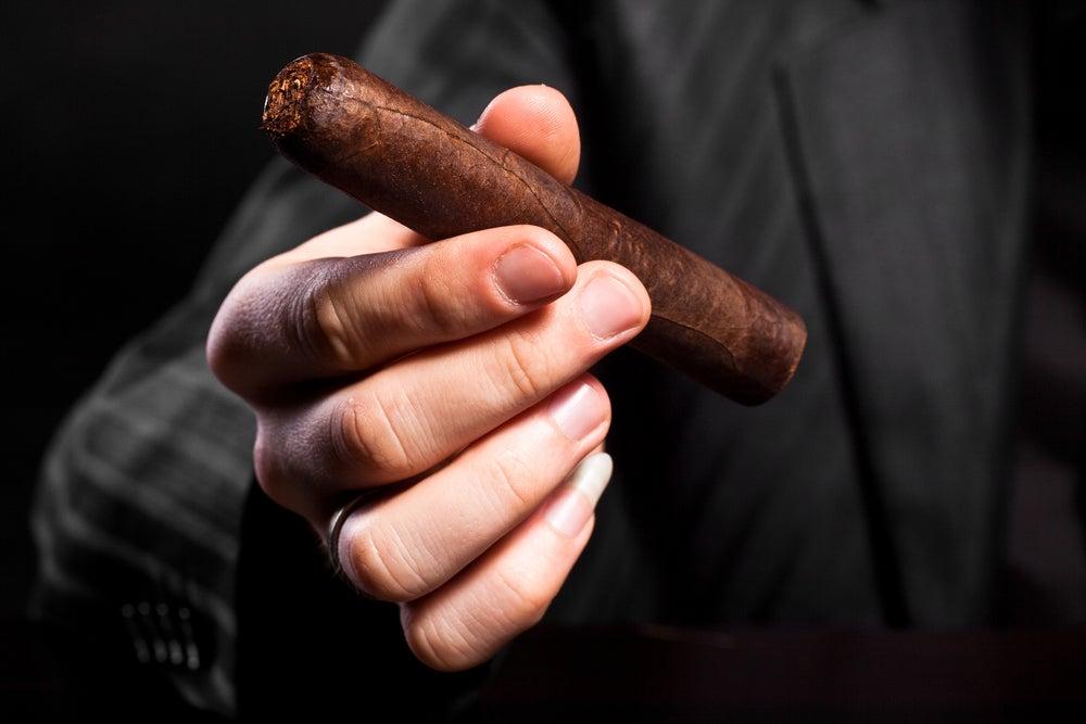 shutterstock_47700049-man-holding-cigar