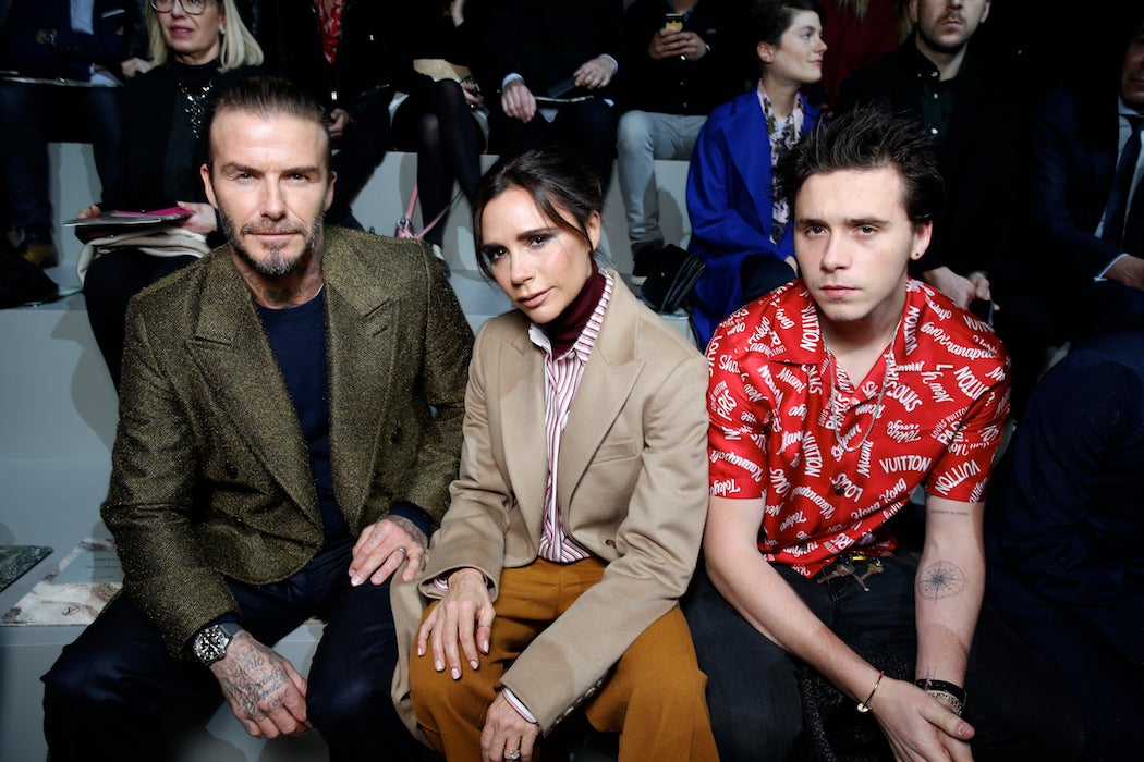 David, Victoria and Brooklyn Beckham at the Louis Vuitton Fall/Winter 2018 runway at Paris Fashion Week (Photo: Courtesy of LOUIS VUITTON) / SWAGGER Magazine