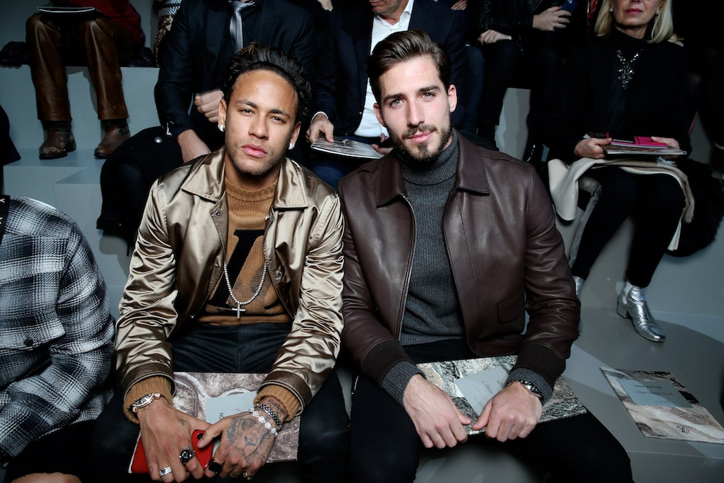 Neymar Jr., and Kevin Trapp front row at the Louis Vuitton Fall/Winter 2018 runway at Paris Fashion Week (Photo: Courtesy of LOUIS VUITTON)