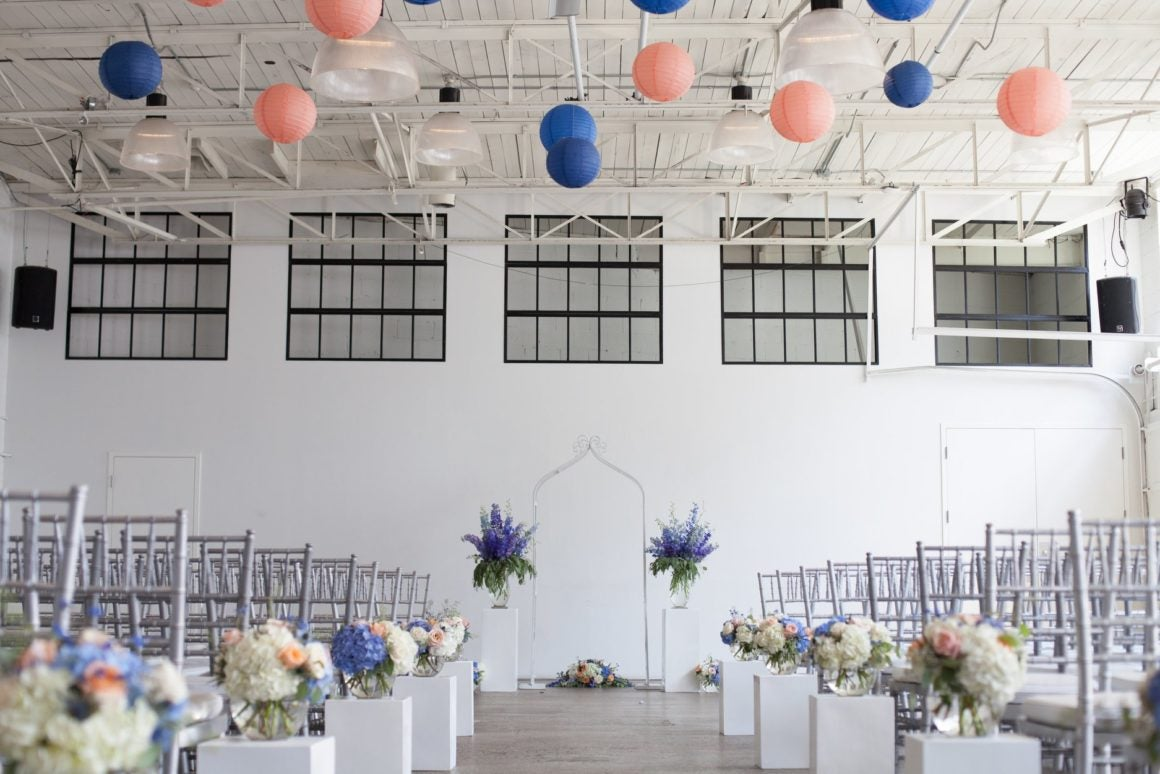 event space with tables, chairs and decor