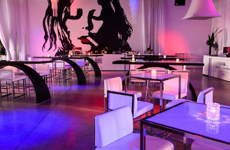 event space with lights, tables and chairs