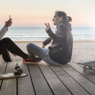 Mobile Trends: Skateboarders taking photo