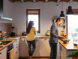 Adult Couple Cooking In The Kitchen.