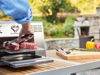 Blazing Bull_Raw Steaks on the Grill